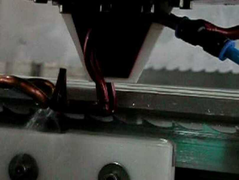 Machine for hardening the teeth of band saw blades